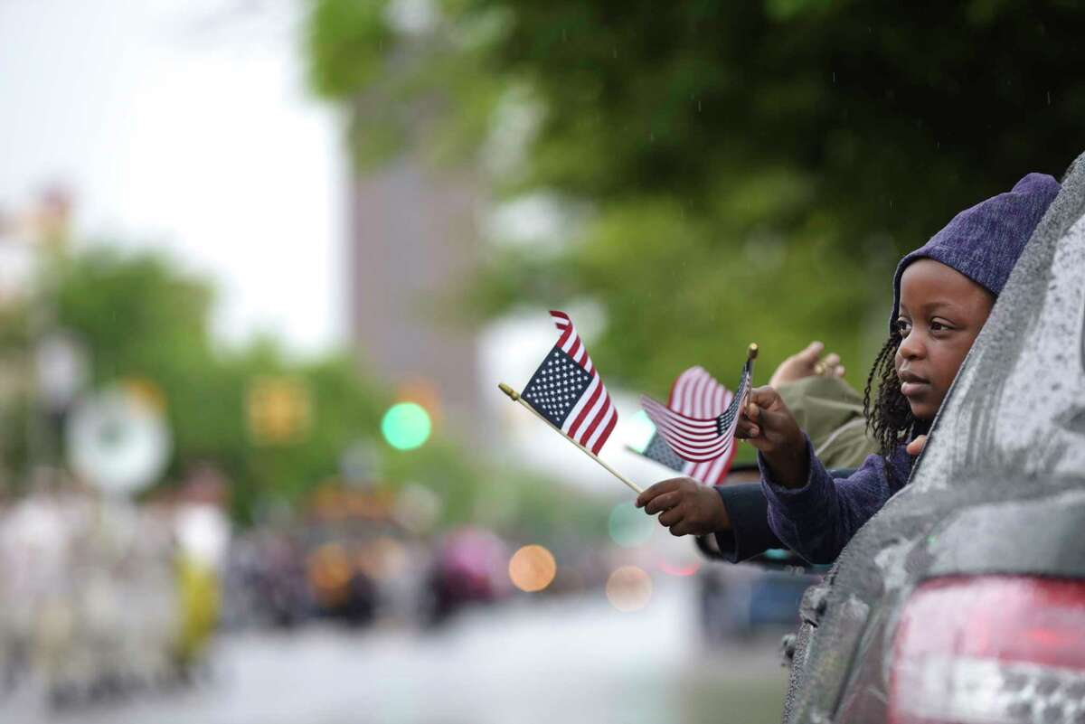 Zahniya Fortune, 5, of Albany watches the Albany Memorial Day Parade go by on Central Ave. from her parent's car on Monday, May 29, 2017, in Albany, N.Y. (Paul Buckowski / Times Union)