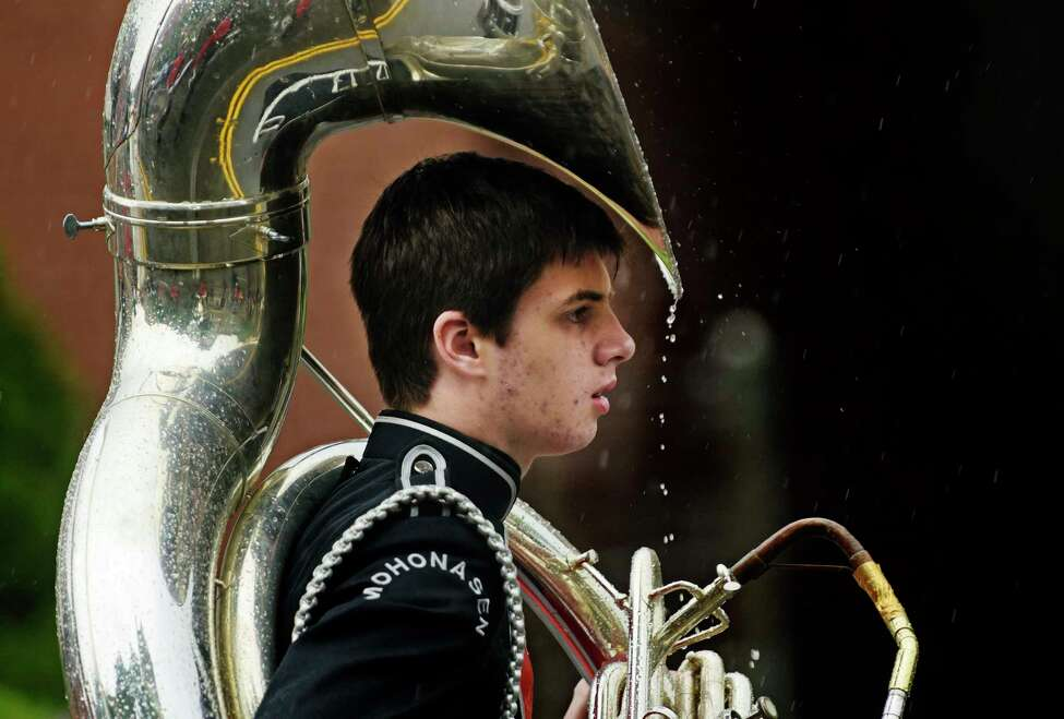 Rain drops fall off the tuba of a member of the Mohonasen Marching Band from Rotterdam during the Albany Memorial Day Parade on Monday, May 29, 2017, in Albany, N.Y. (Paul Buckowski / Times Union)