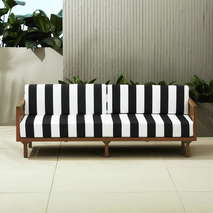 Crate & Barrel's black-and-white, striped sofa makes a bold statement on your patio. $999, cb2.com.
