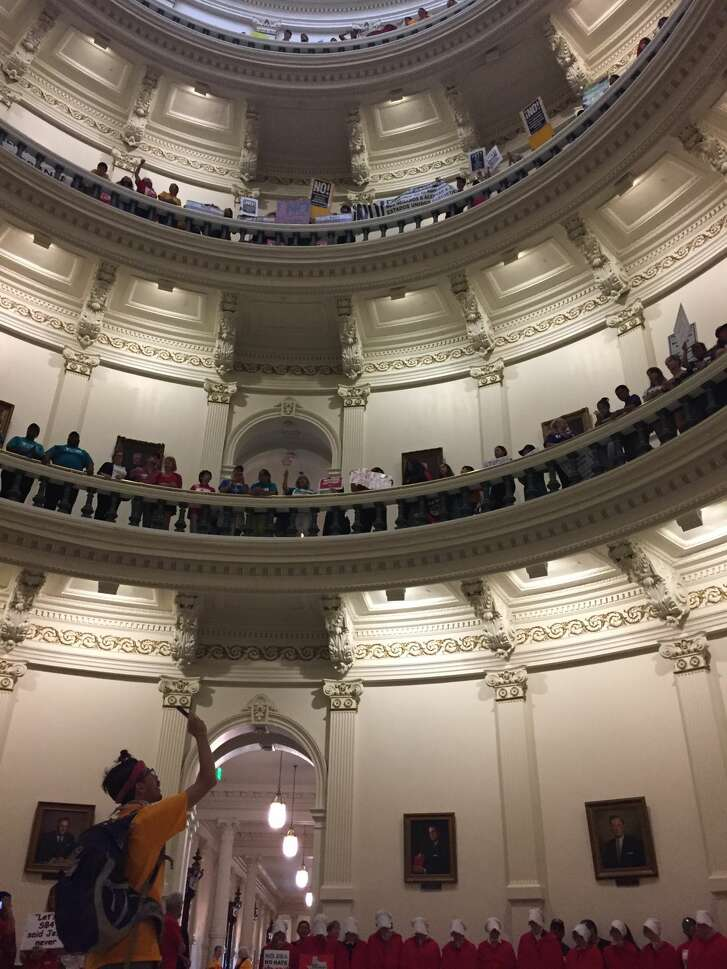 """Protesters gather in the Texas Capitol on Monday, May 29, 2017 to protest the """"sanctuary cities"""" law."""