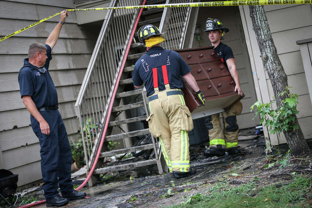 The Woodlands Firefighters Remove A Dresser With Clothes For A Displaced  Resident At An Apartment Building