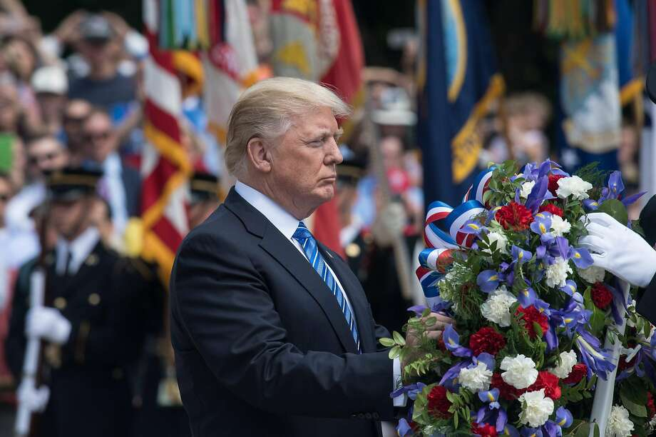 Trump hails those fallen in battle and their families at Arlington