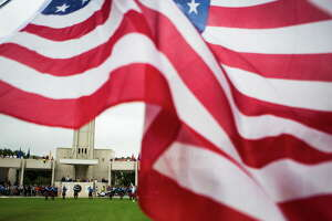The Houston National Cemetery hosts a tribute to those who served in the armed forces of the United States and to their families, Monday, May 29, 2017, in Houston. The event had a parade of the organizations that serve veterans and a POW MIA ceremony.