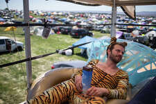 Eddie Carlson relaxes on top of a school bus turned festival-mobile on the third and final day of Sasquatch! Music Festival at the Gorge Amphitheater on Sunday, May 28, 2017.