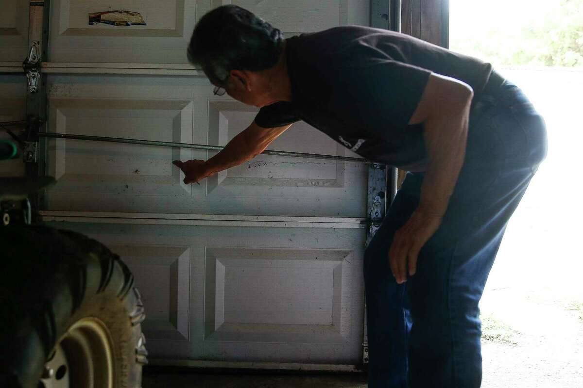 Eulalio Ojeda points at the water line on his garage from Hurricane Ike Monday, May 22, 2017 in Galveston.