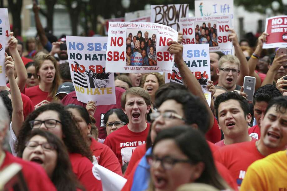 Protesters gather against SB4 at the State Capitol, Monday, May 29, 2017. The bill, known as Sanctuary City, was signed by Governor Greg Abbott and will take effect on Sept. 1, 2017. It gives local law enforcement department the power to question a person's citizenship. Photo: JERRY LARA / San Antonio Express-News / © 2017 San Antonio Express-News