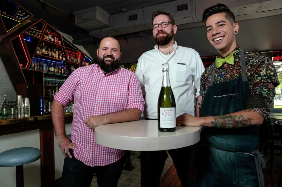 Better Luck Tomorrow's Justin Vann, center, flanked by Terry Williams, left, and Alex Negranza, touts Clotilde Davenne Brut Extra Crémant De Bourgogne. Photo: Brett Coomer, Staff / © 2017 Houston Chronicle