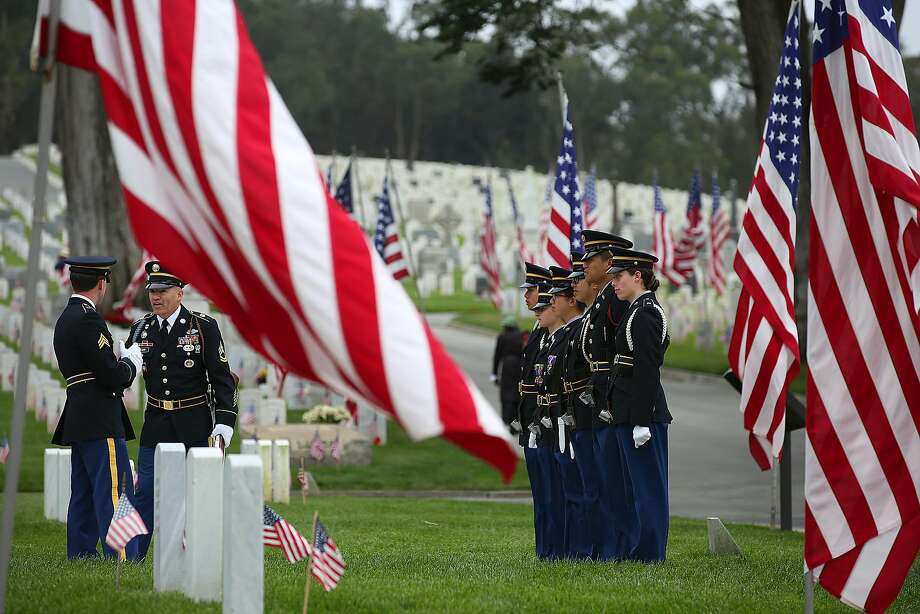 The U.S. Army Reserve Color Guard from Camp Parks in Dublin practices before the Memorial Day ceremony at the Presidio cemetery. Photo: Liz Hafalia, The Chronicle