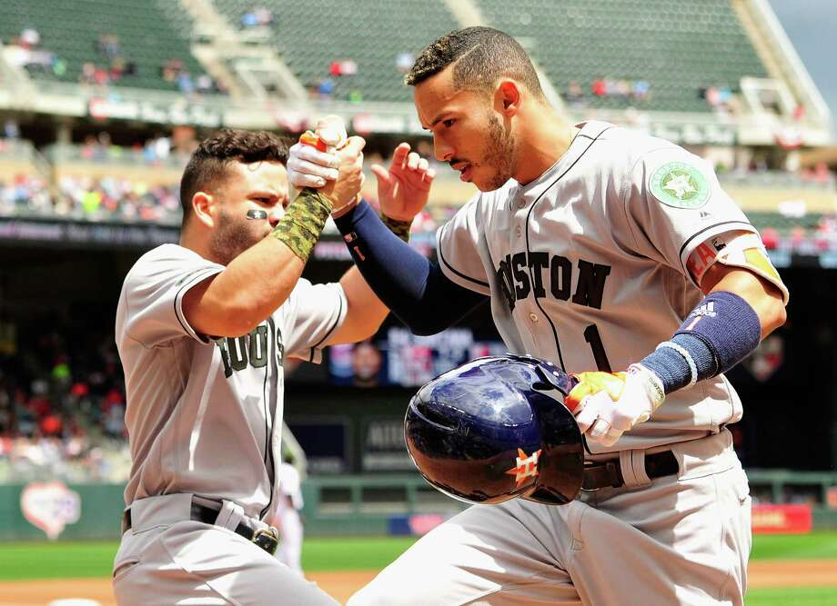 MINNEAPOLIS, MN - MAY 29: Jose Altuve #27 of the Houston Astros congratulates teammate Carlos Correa #1 on solo home run against the Minnesota Twins during the fourth inning of the game on May 29, 2017 at Target Field in Minneapolis, Minnesota. Photo: Hannah Foslien, Getty Images / 2017 Getty Images