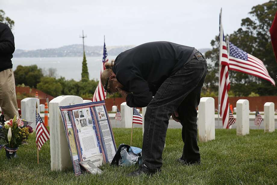 Kevin Claire visits the tombstone of his brother Kenneth Wm Claire who served in the Vietnam war at the Presidio cemetery during memorial day on Monday, May 29 , 2017,  in San Francisco, Calif. Photo: Liz Hafalia, The Chronicle