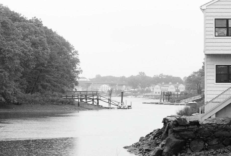 A look down the Saugatuck River from Riverside Avenue through a rainy haze Monday in Westport. Photo: Laura Weiss / Hearst Connecticut Media / Westport News
