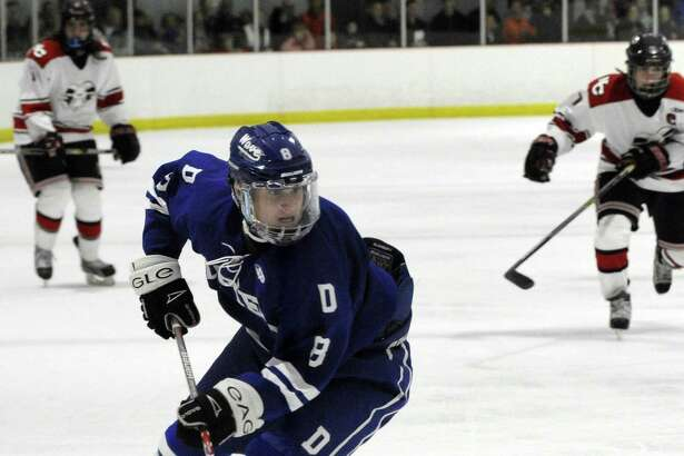 Darien's Arden Cohen takes the puck in a FCIAC boys varsity ice hockey game against New Canaan at the Darien Ice Rink on Dec. 27, 2016. New Canaan defeated Darien 5-2.