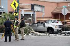 Police investigators take measurements on the street after a fatal vehicle collision in Alameda, Calif., on Monday, May 29, 2017.