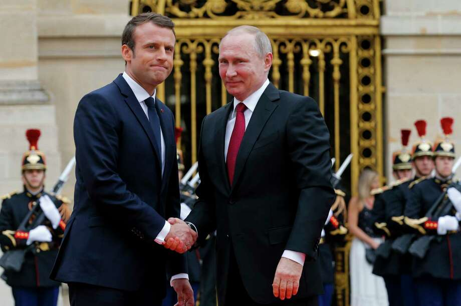 Russian President Vladimir Putin, right, is welcomed by French President Emmanuel Macron at the Palace of Versailles, near Paris, France, Monday, May 29, 2017. Monday's meeting comes in the wake of the Group of Seven's summit over the weekend where relations with Russia were part of the agenda, making Macron the first Western leader to speak to Putin after the talks. (AP Photo/Alexander Zemlianichenko, pool) Photo: Alexander Zemlianichenko, POOL / AP POOL