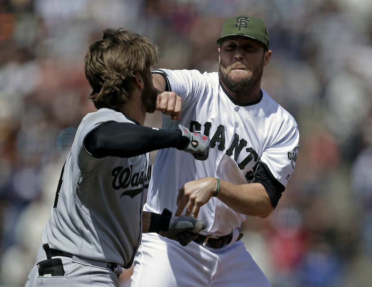 Washington Nationals' Bryce Harper, left, prepares to hit San Francisco Giants' Hunter Strickland after being hit with a pitch in the eighth inning of a baseball game Monday, May 29, 2017, in San Francisco. (AP Photo/Ben Margot)