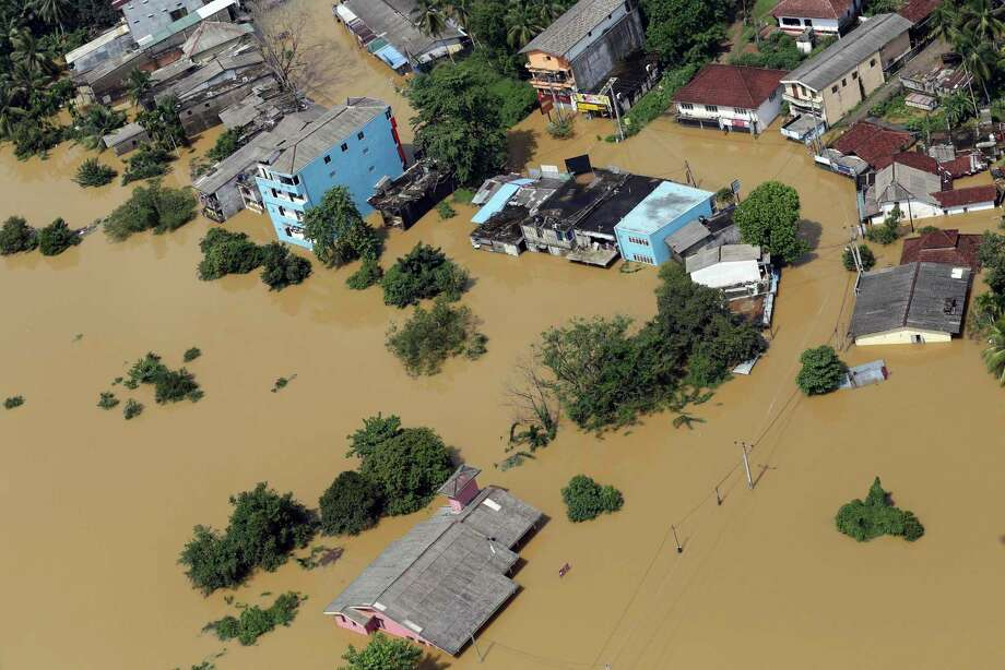 The devastation in the inundated area of Kiriella, in the Ratnapura district of Sri Lanka, is widespread. More than 75,000 people have been taken to relief camps. Photo: Rukmal Gamage, STR / Copyright 2017 The Associated Press. All rights reserved.