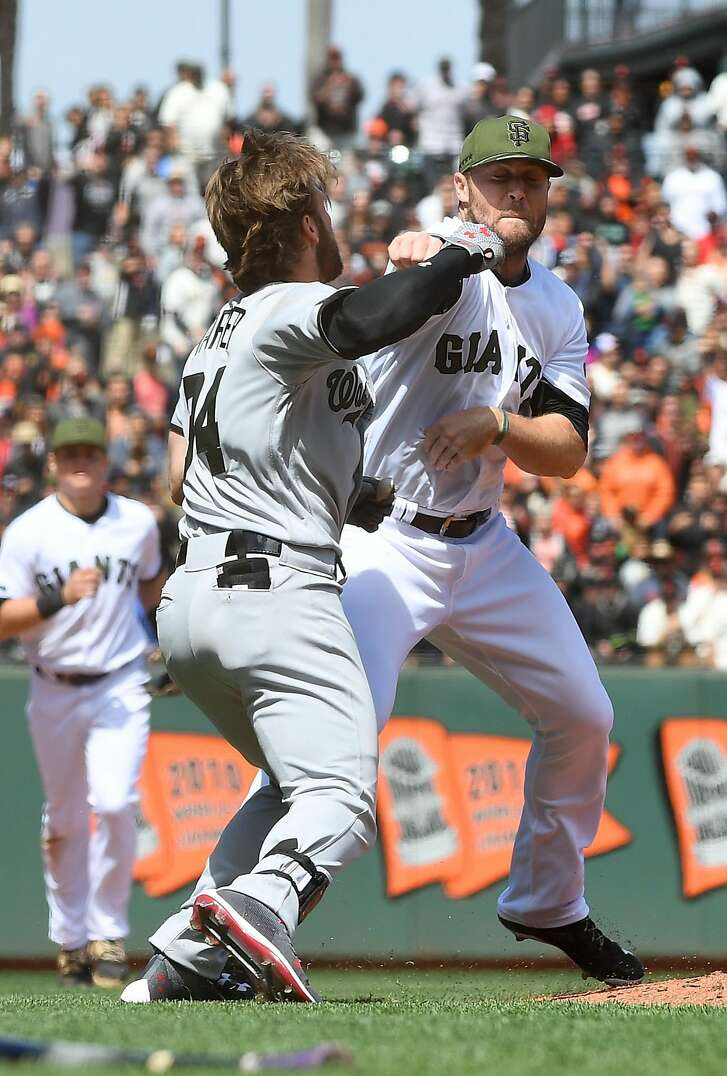SAN FRANCISCO, CA - MAY 29:  Bryce Harper #34 of the Washington Nationals and Hunter Strickland #60 of the San Francisco Giants throw punches at one another after Strickland hit Harper with a pitch in the top of the eighth inning at AT&T Park on May 29, 2017 in San Francisco, California.  (Photo by Thearon W. Henderson/Getty Images)