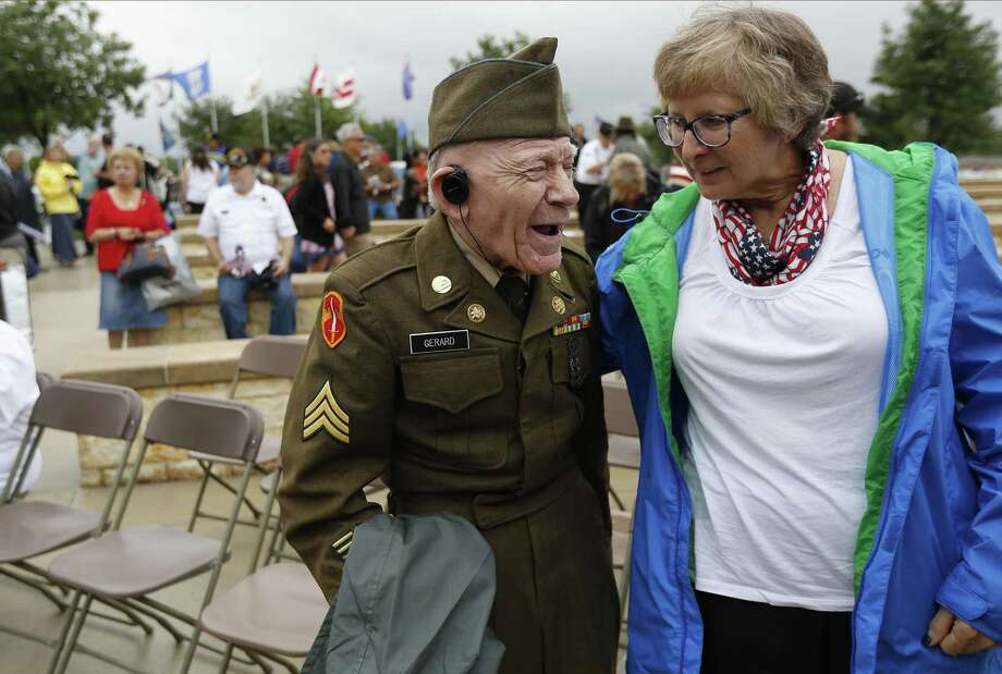 Korean War veteran Sgt. James Francis Joseph Gerard shares a lighter moment with Millie Goodman Kralich (right) at the conclusion of the Memorial Day ceremony at Fort Sam Houston National Cemetery on Monday, May 29, 2017. (Kin Man Hui/San Antonio Express-News) Photo: Kin Man Hui, Staff / San Antonio Express-News / ©2017 San Antonio Express-News