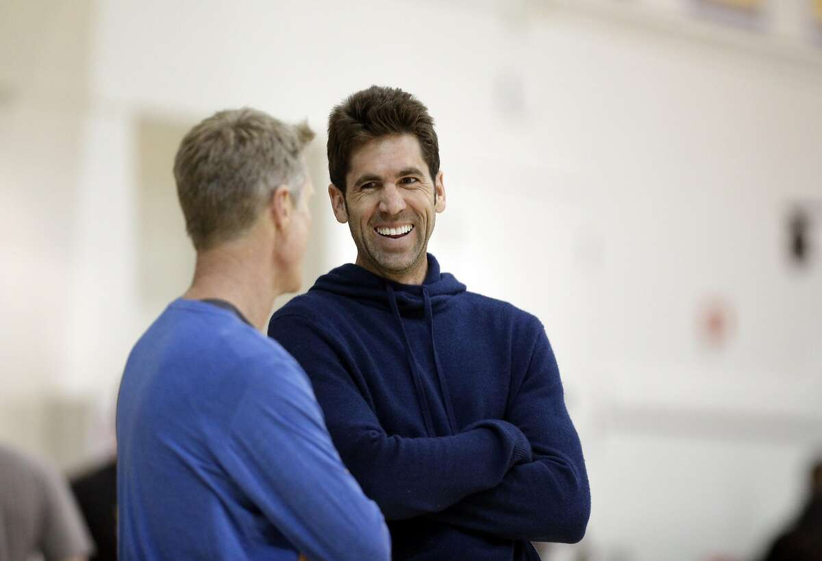 Warriors General Manager Bob Myers laughs with Head Coach Steve Kerr during practice at the Warriors headquarters in Oakland, Calif., on Monday, May 29, 2017.