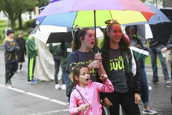 From right, Maliyah Bufano, 13, Sara Brescia, 12, and Jenna Brescia, 7, wait for the New Milford Memorial Day parade to begin on Monday, May 29 in New Milford, Conn.