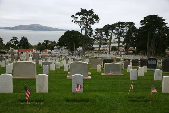 View of the Presidio cemetery during memorial  day from top of hill Monday, May 29 , 2017,  in San Francisco, Calif.