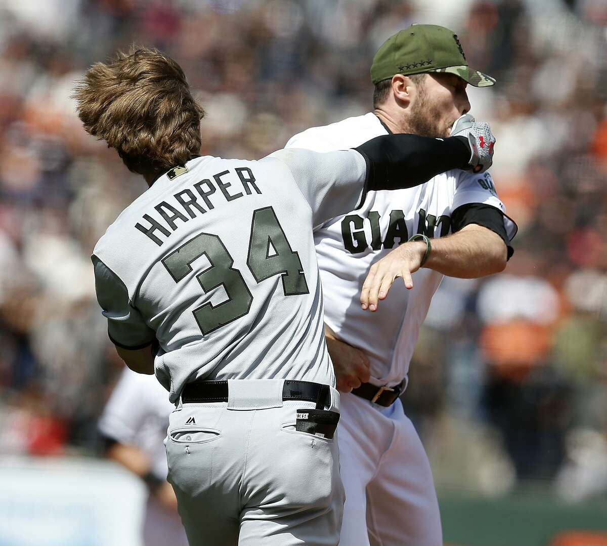 San Francisco Giants pitcher Hunter Strickland is punched by Washington Nationals' Bryce Harper (34) during the eighth inning on Monday, May 29, 2017, in San Francisco, Calif. Harper was hit by a pitch from Strickland, starting a fight between the two teams. (Aric Crabb/Bay Area News Group/TNS)