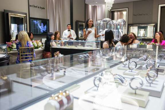 Store manager Shamika Johnson talks about her friend Tammy Tran Nguyen during a birthday party for Nguyen at Van Cleef & Arpels, Tuesday, May 9, 2017, in Houston. Nguyen founded the organization Know Autism and has partnered with Van Cleef & Arpels for her foundation in the past after starting their relationship as a client. (Mark Mulligan / Houston Chronicle)