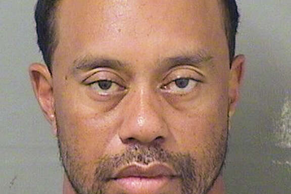Tiger Woods is in a disheveled state in the booking photo from his DUI arrest.