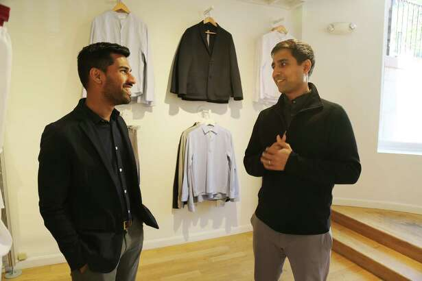 Gihan Amarasiriwardena, left, Ministry of Supply's chief design officer, and chief executive Aman Advani talk in their flagship store in Boston.