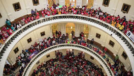 Hundreds of protesters line the balconies of the state Capitol rotunda  in Austin on Monday, May 29, 2017, the last day of the legislative  session, to protest Senate Bill 4.