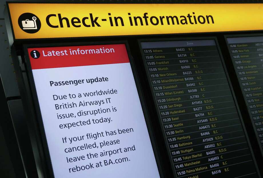 "A displays warning passengers to ""Expect Disruption"" to British Airways flights, is pictured inside Terminal 5 of London's Heathrow Airport on May 29, 2017. Passengers faced a third day of disruption at Heathrow Monday as British Airways cancelled short-haul flights after a global computer crash that unions blamed on the outsourcing of IT services to India. The embattled airline said it was cancelling 13 short-haul flights from Heathrow Airport, Europe's busiest, but was aiming to operate a full long-haul schedule from the hub and was operating a full service from Gatwick Airport. / AFP PHOTO / Daniel LEAL-OLIVASDANIEL LEAL-OLIVAS/AFP/Getty Images Photo: DANIEL LEAL-OLIVAS, Stringer / AFP or licensors"