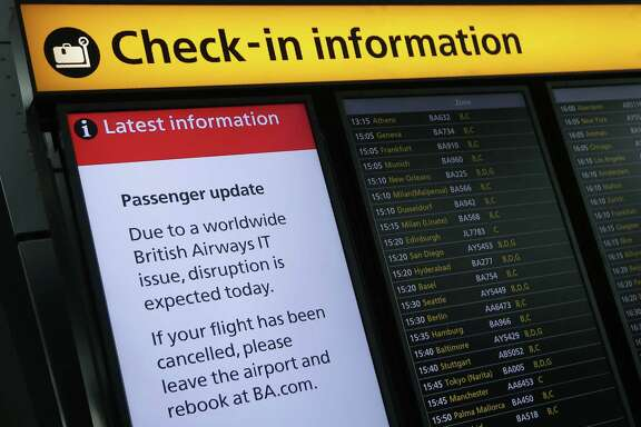 "A displays warning passengers to ""Expect Disruption"" to British Airways flights, is pictured inside Terminal 5 of London's Heathrow Airport on May 29, 2017. Passengers faced a third day of disruption at Heathrow Monday as British Airways cancelled short-haul flights after a global computer crash that unions blamed on the outsourcing of IT services to India. The embattled airline said it was cancelling 13 short-haul flights from Heathrow Airport, Europe's busiest, but was aiming to operate a full long-haul schedule from the hub and was operating a full service from Gatwick Airport. / AFP PHOTO / Daniel LEAL-OLIVASDANIEL LEAL-OLIVAS/AFP/Getty Images"