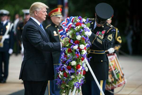 President Donald Trump lays a wreath at the Tomb of the Unknown Soldier during a ceremony at Arlington National Cemetery on Memorial Day in Arlington, Va., May 29, 2017. (Al Drago/The New York Times) ORG XMIT: XNYT36