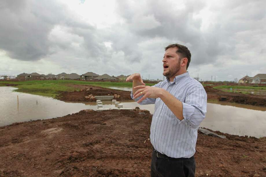 TBG Partners Principal Meade Mitchell talks about the wetland park in the Riverstone Development, Tuesday, March 7, 2017, in Sugar Land. Developers say master planned communities are trending away from fancy amenities and towards vibes of authenticity and connection with the land. Good bye to golf courses and swimming pools, hello to urban farm plots, natural waterways and wild space. Wetland Park, which will be wetland themed in homage to its natural ancestry, with preserved wetland space and rugged-esque trails throughout. ( Steve Gonzales  / Houston Chronicle ) Photo: Steve Gonzales, Staff / © 2017 Houston Chronicle