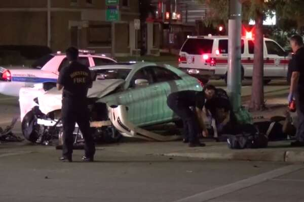 Police are investigating a crash that injured Monday four apparently homeless people sleeping in downtown Houston. (Metro Video)