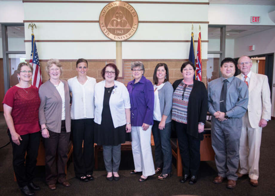 The recipients of the Carleen K. Moore R.N. Nursing Excellence awards for 2017 gather during an awards ceremony May 22 at Saginaw Valley State University Monday. Pictured from left are: Rebecca Morgan, Cathy Campbell, Jennifer Swartz, Julie Wright, Carleen Moore, Trisha Slough, Jackie Dost, Gordon Liu and Terry Moore.