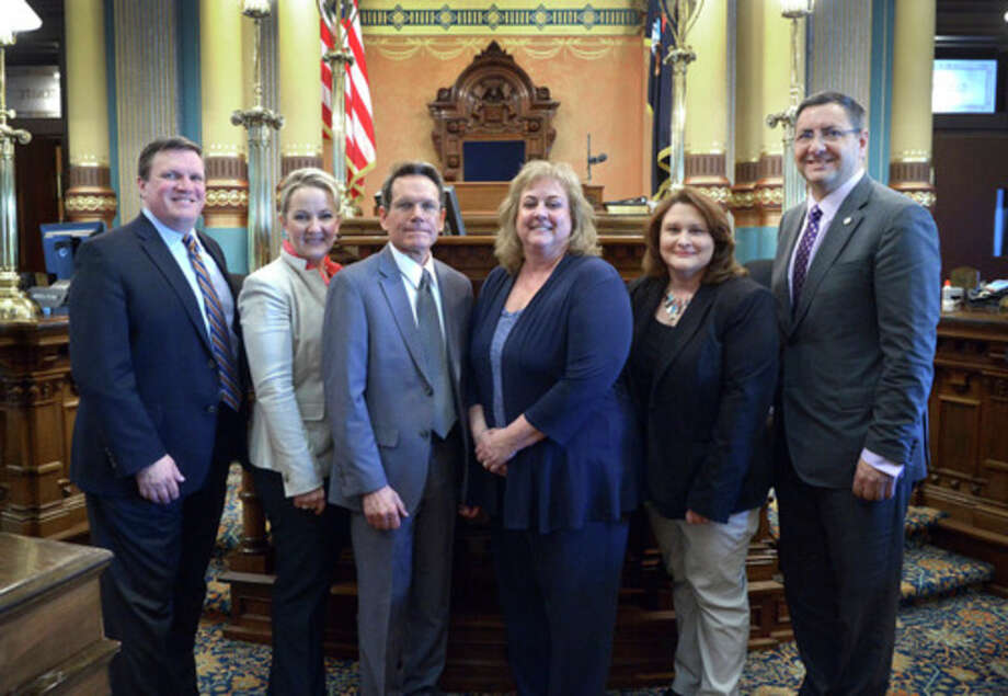 Sens. Jim Stamas, R-Midland, and Wayne Schmidt, R-Traverse City, welcomed board members and staff from Michigan Community Action to the Capitol on May 9. Pictured from left: Schmidt; Northeast Michigan Community Service Agency Executive Director Lisa Bolen; Northwest Michigan Community Action Agency Executive Director John Stephenson; Mid Michigan Community Action Executive Director Jill Sutton; and Stamas.