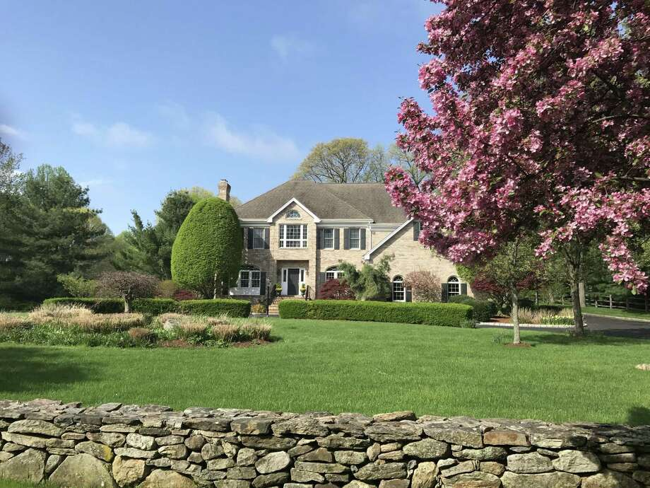 The brick and wood colonial house at 520 Queens Grant Road was built in in 1995 and it has 4,986 square feet of living space, an open floor plan and abundance of natural light.