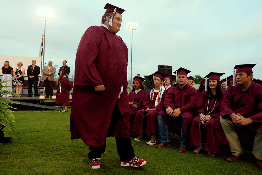 Dakota Martin walks to his seat before graduating from Silsbee High School on Friday evening. Martin battled cancer his sophomore year, and his family didn't know if he'd make it to graduation. Martin is in remission.  Photo taken Friday 5/26/17 Ryan Pelham/The Enterprise Photo: Ryan Pelham / ©2017 The Beaumont Enterprise/Ryan Pelham