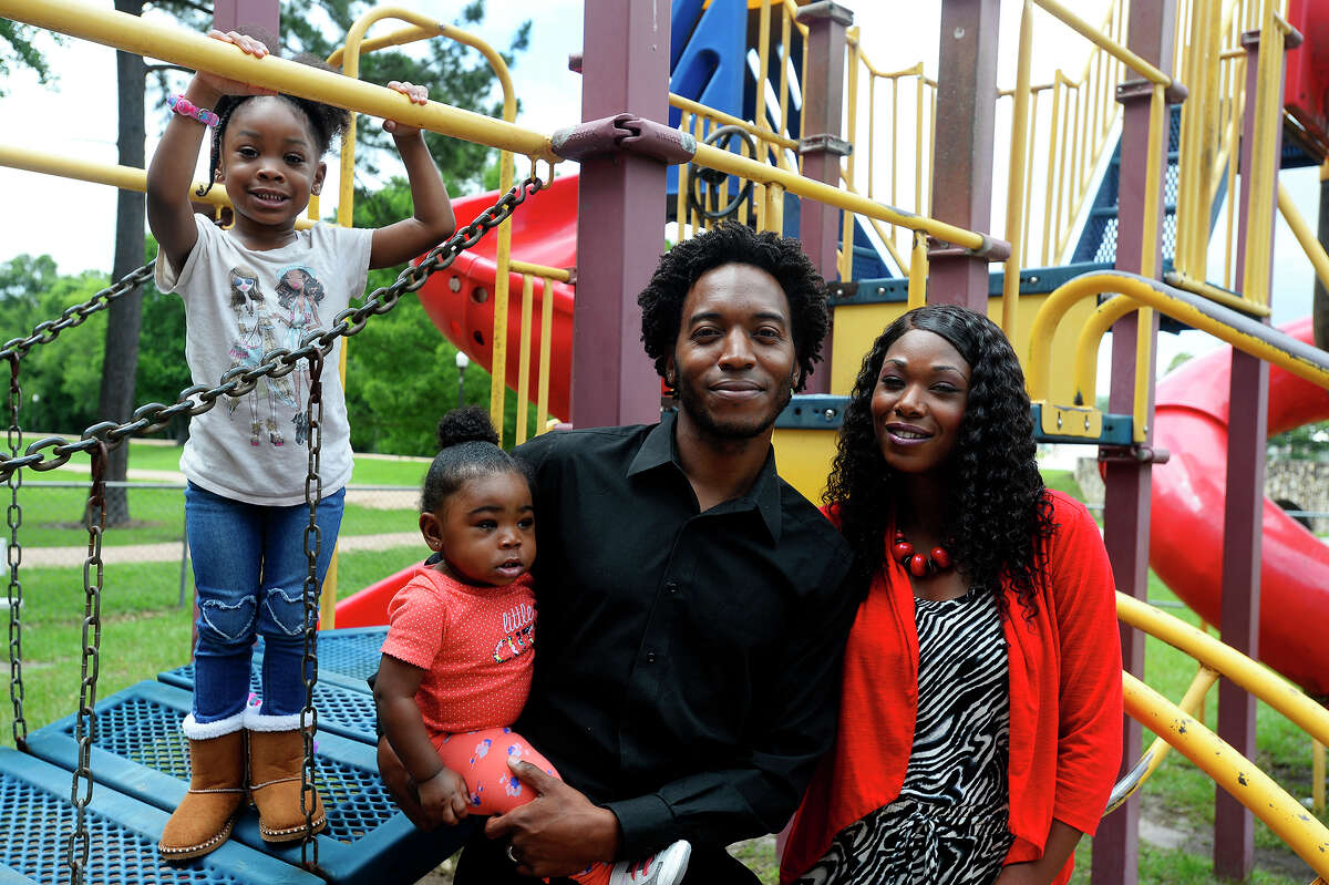 Jasper city councilman Rashad Lewis poses with his wife, Ronzie, and daughters Zoe, 3, and Riley, 1, at the city's Sandy Creek Park. Lewis hopes to bring more things to help the city's youth. Photo taken Tuesday 5/23/17 Ryan Pelham/The Enterprise