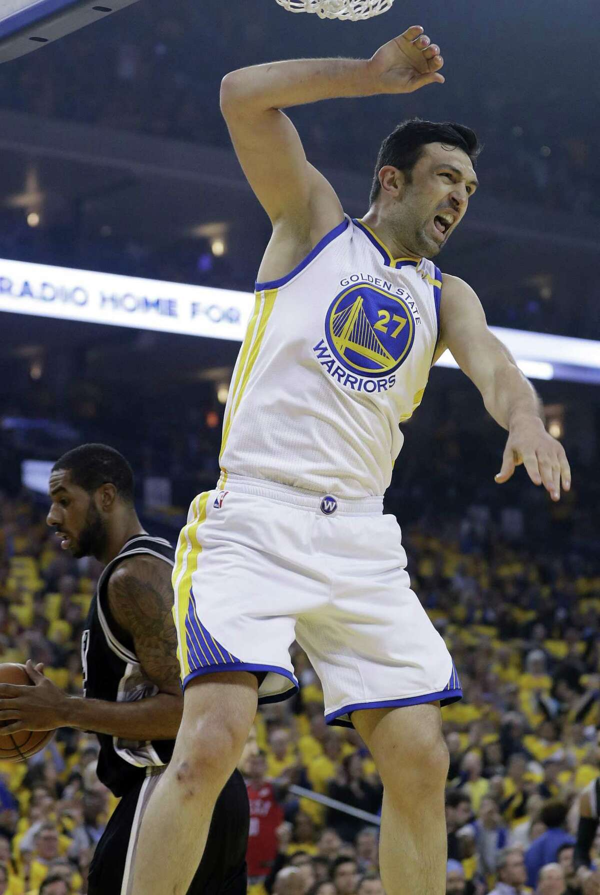 Golden State's Zaza Pachulia celebrates after he dunks on the Spurs during Game 2 on May 16.