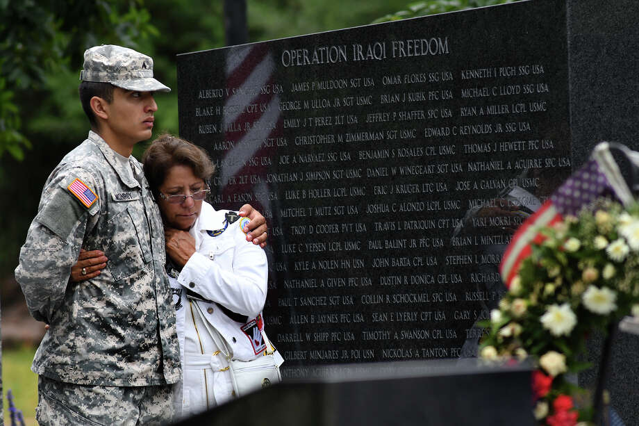 Cpl. Hector Monroy, left, of the Texas National Guard in Houston, hugs Maria Salgado Rosales, of Katy, whose son, Cpl. Benjamin Rosales (USMC), was killed in action in Iraq in 2006, during the Memorial Day tribute held at the Fallen Warriors Memorial in Cypress on May 29, 2017. (Photo by Jerry Baker/Freelance) Photo: Jerry Baker, Freelance / Freelance