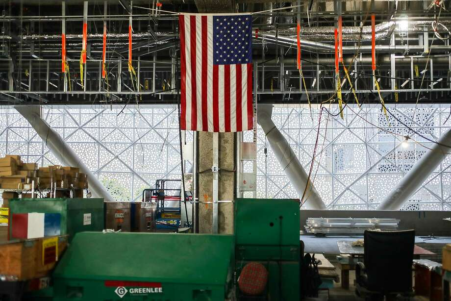 An American flag hangs in the under-construction Transbay Transit Center on May 17. Photo: Gabrielle Lurie, The Chronicle