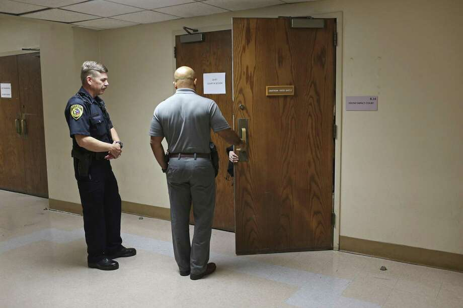 A San Antonio Police Department witness enters the Bexar County Impact Court in the basement of the Bexar County Courthouse, Monday, May 8, 2017. Judge Laura Parker presides over the court that is designed to take some of the cases from courts that have huge dockets while also reducing the overpopulation problem at the Bexar County Jail. Photo: JERRY LARA / San Antonio Express-News / © 2017 San Antonio Express-News