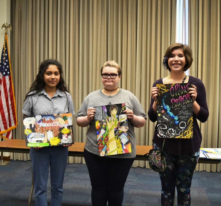 The high school winners in the Midland Crime Stoppers annual poster contest are Daisy Gonzalez, from left, Katharine Spurgeon and Allison Gamertsfelder. Photo: Courtesy Photo