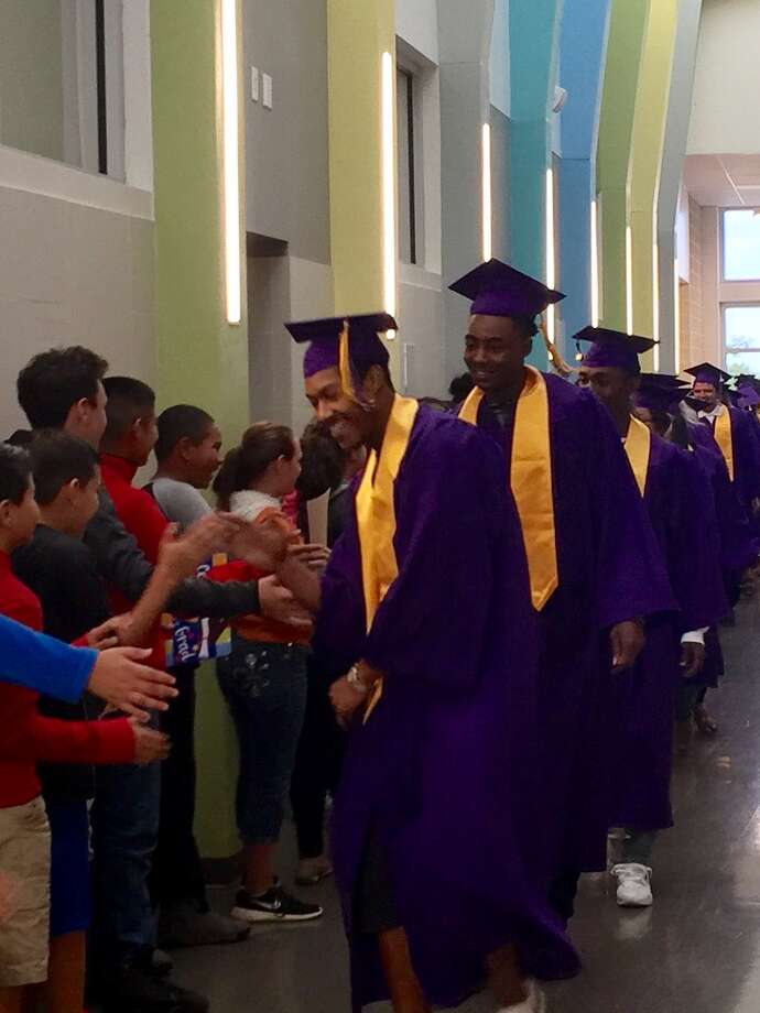 Graduating seniors from Lee High School and Midland High School participated in Midland ISD's first Grad March. They visited elementary schools dressed in their caps and gowns. Photo: Courtesy Photo