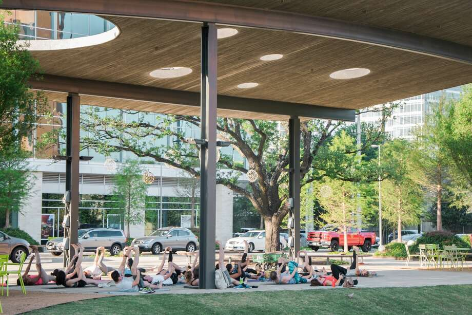 The park's programming includes yoga classes. Above, aA light, sweeping pavilion designed by Natalye Appel Associates features a playfully porous roofscape that mirrors the elegant  horizontal reach of neighboring trees. Photo: Janet Ni