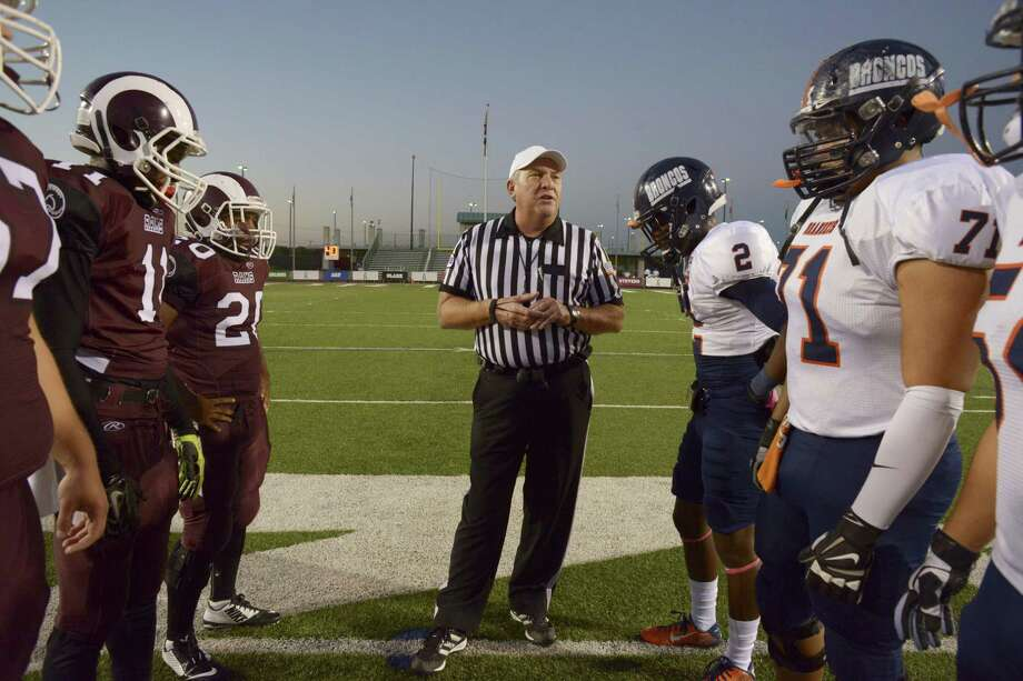 Referee Charlie Wernette meets with team captains of Marshall and Brandeis before their high school football game at Farris Stadium on Oct. 17, 2014. Photo: Billy Calzada /San Antonio Express-News