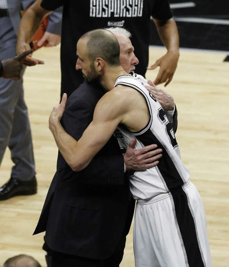 Spurs head coach Gregg Popovich gives Manu Ginobili (20) a hug as he he goes in as starter for Game 4 against the Golden State Warriors during the Western Conference Finals at the AT&T Center on Monday, May 22, 2017. (Kin Man Hui/San Antonio Express-News) Photo: Kin Man Hui, Staff / San Antonio Express-News / ©2017 San Antonio Express-News