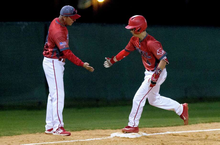 Eric Oakes #4 of Tomball gets a high-five from head coach Doug Rush after hitting a two-run home run off Willis starting pitcher Blake Holub (23) during the fifth inning of a District 20-5A high school baseball game at Wildkat Baseball Complex Tuesday, March 14, 2017, in Willis. Tomball defeated Willis 8-1. Photo: Jason Fochtman, Staff Photographer / © 2017 Houston Chronicle